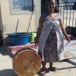 Sangoma and Drum in Township